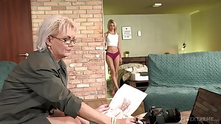 Sexy GILF photographer having sex with a pretty young unspecified