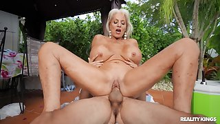 Mommy rides the pole abiding pacified though she's 60 yo