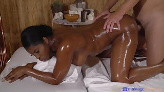 Interracial fucking during non-malignant rub-down surrounding a curvy ebony