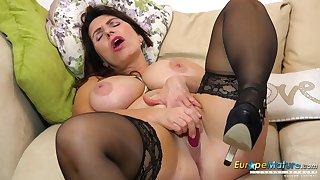 Solo horny mature Josephine on her Davenport masturbates with her vibrating gewgaw